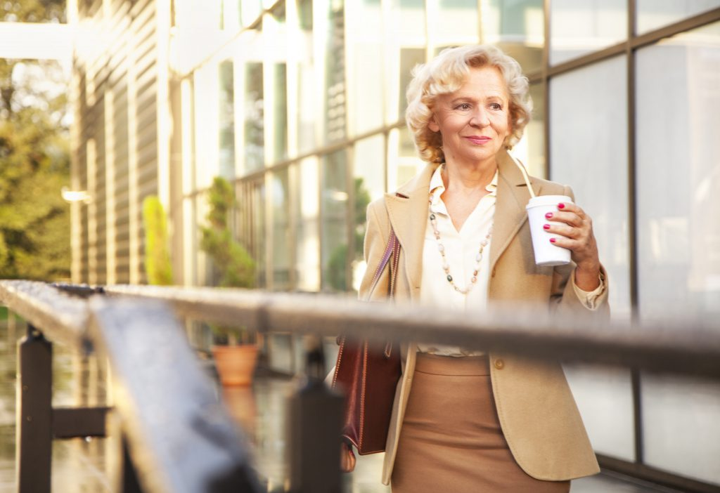 Blonde elderly business woman, coffee break, outdoor